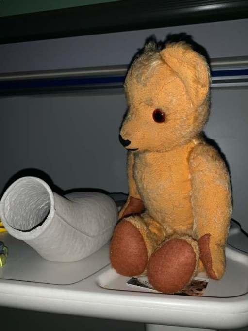 Eamonn sitting next to Bobby's bed pan...