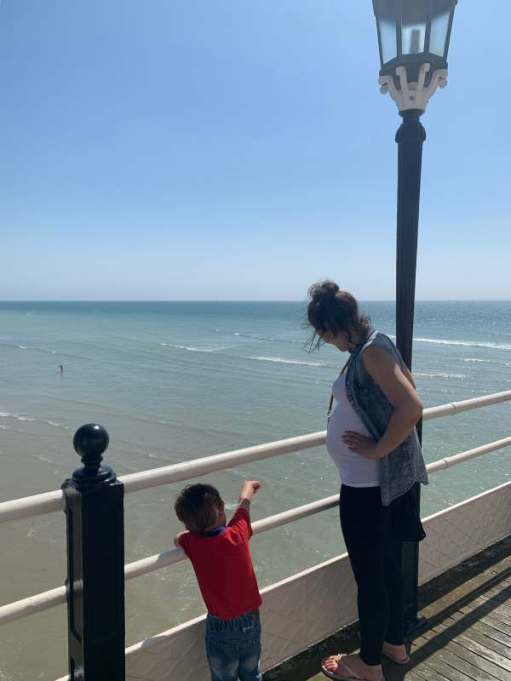 Jasmine and Little Jay looking out to sea from Worthing Pier.