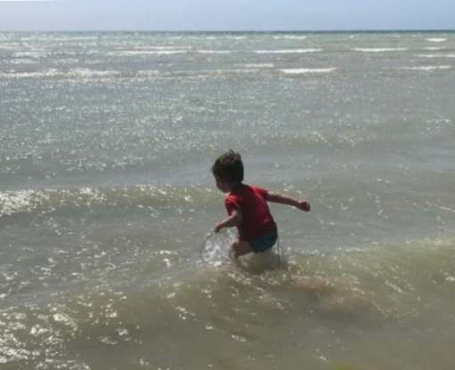 Little Jay playing in the sea at Worthing.
