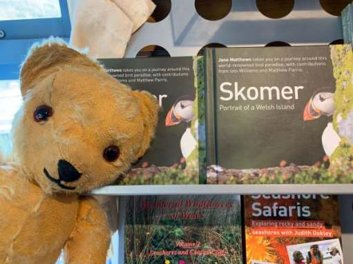 Eamonn in front of some books, including one on Skomer.