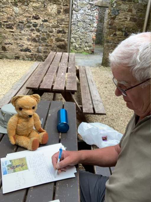 Writing letters to the grandchildren and great grandson.