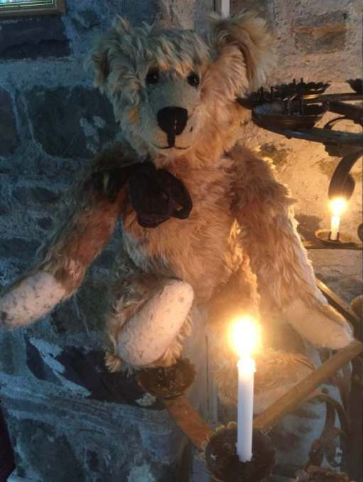Bertie and a candle lit for Diddley in Pembrokeshire.