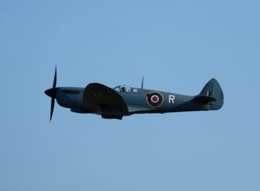 Spitfire in the air at Duxford 2019.