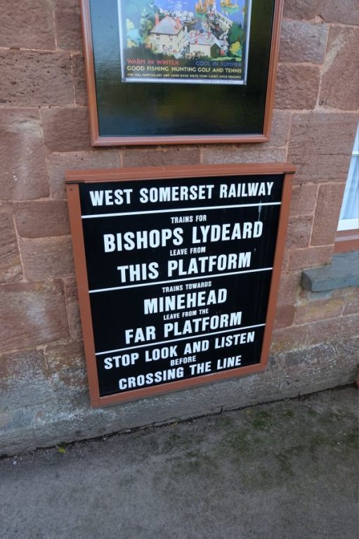 West Somerset Railway station sign. Trains to Bishops Lydeard This Platform; Trains to Minehead Far Platform.