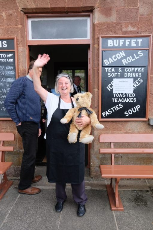 West Somerset Railway - The lady of the café at Stogumber holding Bertie and waving.
