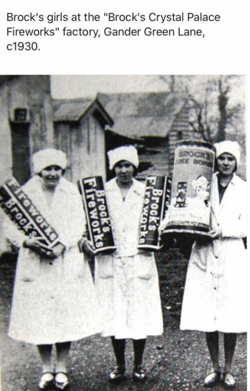 Three female workers holding up some massive fireworks at the Brocks Factory in the 1930s.