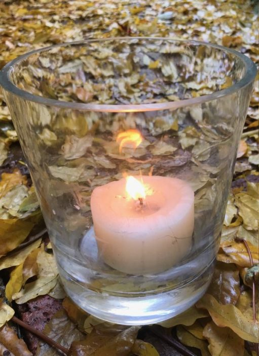 A candle lit for Diddley amongst the autumn leaves in Abinger Roughs.