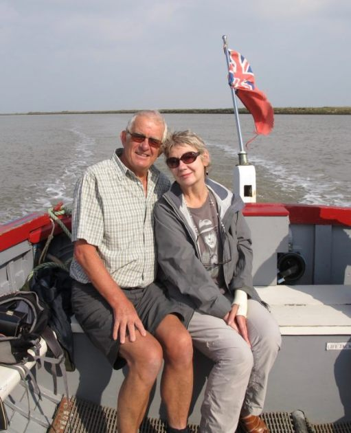 Bobby & Diddley on the back of a small trip boat on the River Orford.
