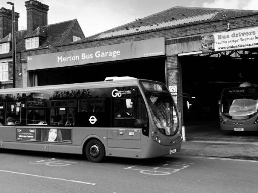 Merton Bus Garage, with a Wrightbus Streetlite outside and another parked inside.
