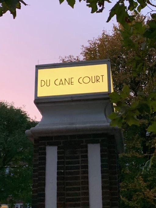 "Illuminated gatepost sign ""Du Cane Court""."