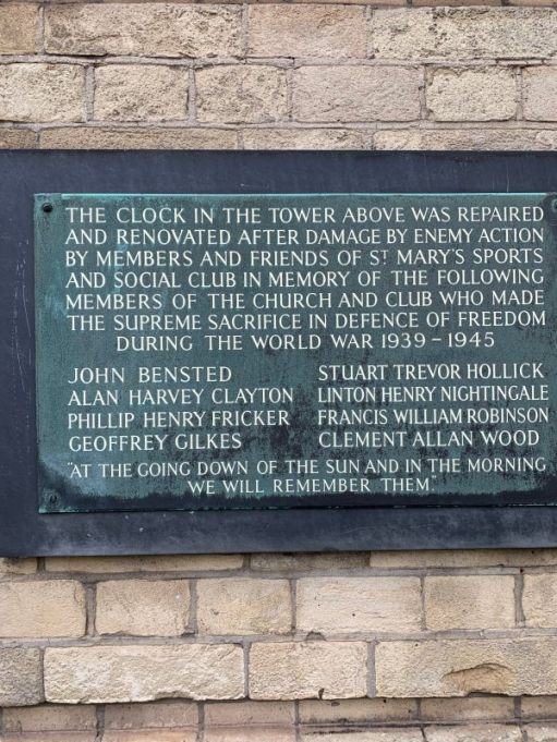 Memorial plaque on St Mary and St John the Divine wall referring to the renovations to the clock following bomb damage during the war.