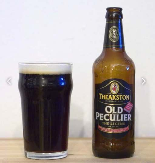 A pint glass and a bottle of Theakston Old Peculier.
