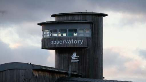 The Observatory Tower at Slimbridge, with the WWT logo. The Clouds of Storm Dennis are gathering.
