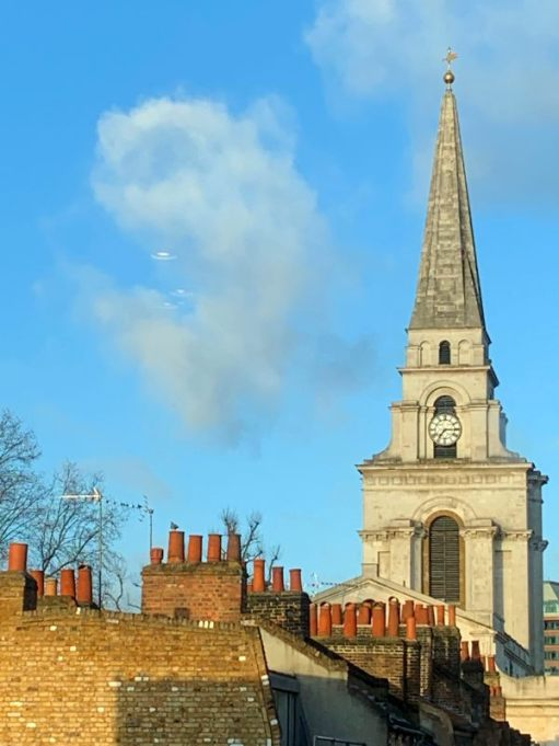 The chimney pots of Spitalfields. The magnificent Christ Church towering above.