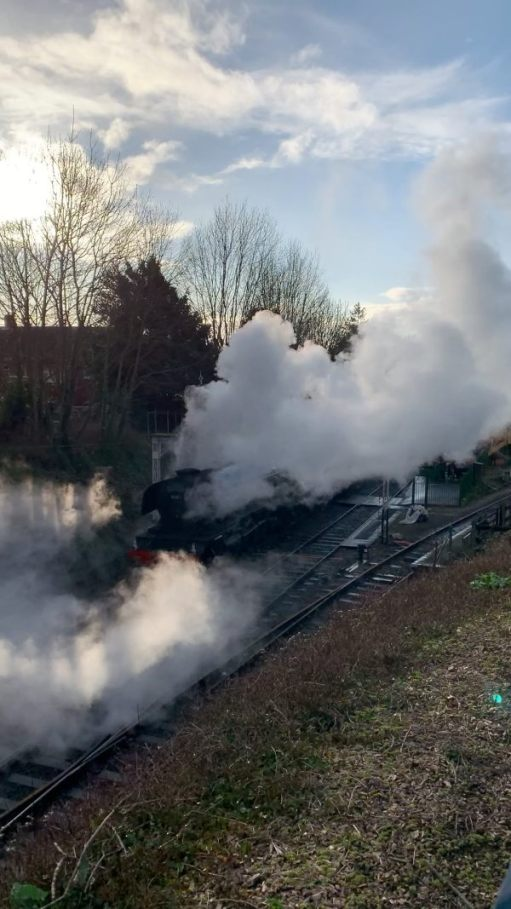 The Flying Scotsman departing Alresford in an impressive cloud of steam.