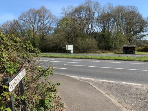 Warwick Road. The usually busy A24 dual carriageway. The bus shelter. The Common beyond.