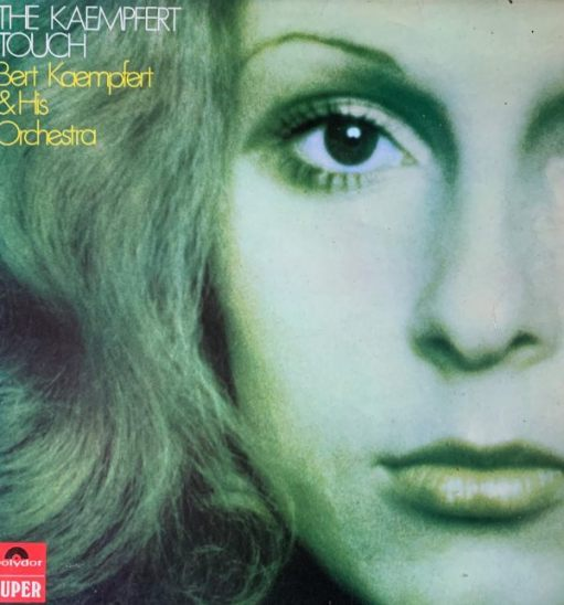 """Album cover - """"The Kaempfert Touch - Bert Kaempfert and his Orchestra"""". Picture of the left side of a lady's face, with blond hair cascading down."""