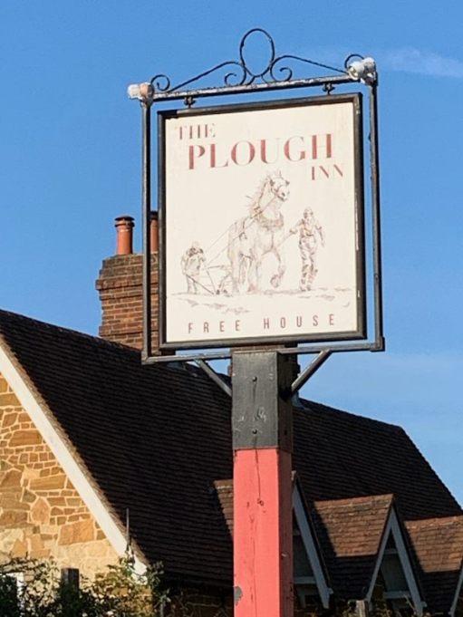 Sign for the Plough Inn. Free House.