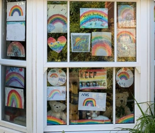 The window at Laurel Cottage with Trevor, Eamonn and Bertie sat amongst all the rainbows, etc.