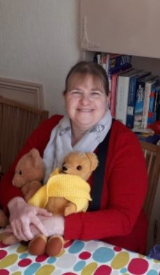 Carol sat at the table with Eamonn (wearing his new scarf) and Henry bear.
