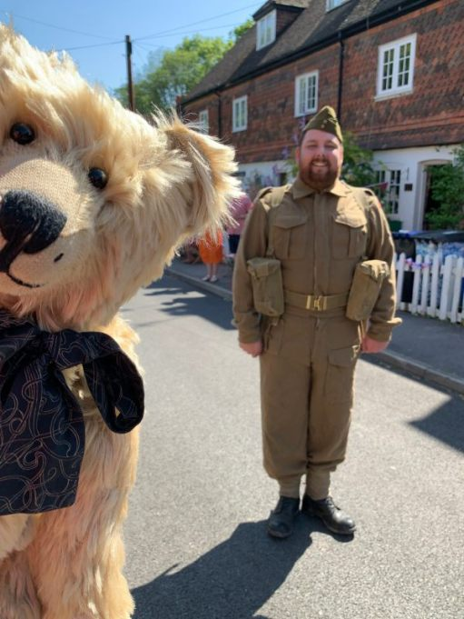 Man dressed up as a soldier, with Bertie photobombing the picture!