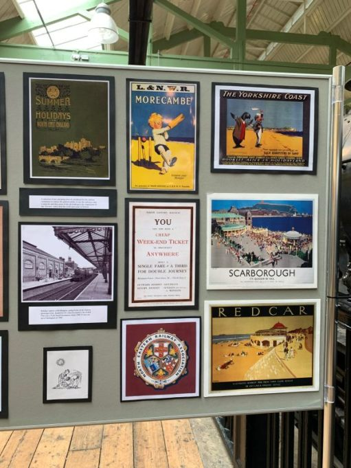 A display board of old railway posters.