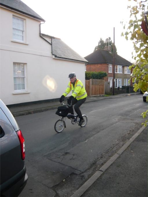 Bobby on the Brompton wearing Hi-Vis and Hard Hat.
