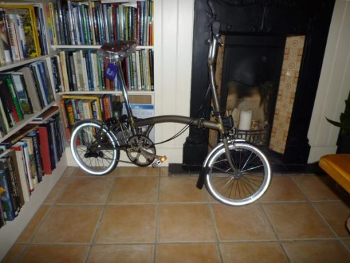 The Brand new Brompton bike in the lounge leant up against the bookcase alongside the fireplace.