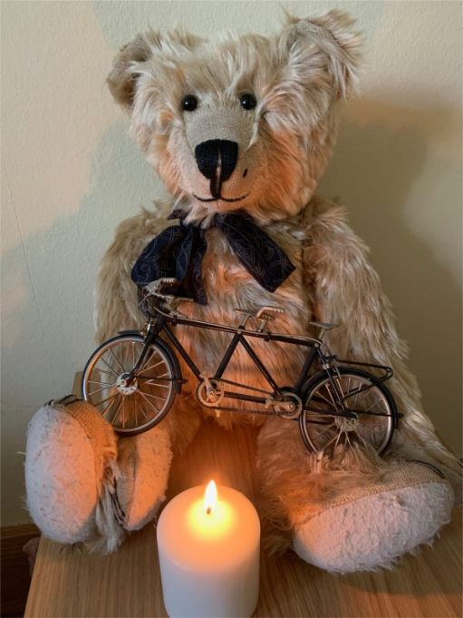 Bertie sat on a table with a model tandem on his lap and a candle lit for Diddley in front.