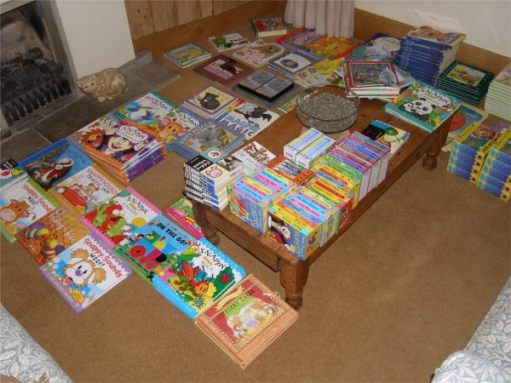 Sorting out dozens of brand new children's books.