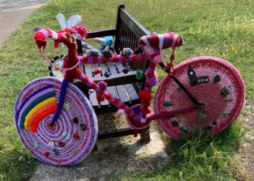 "Yarnbomb Sisters - knitted bicycle complete with ""NHS rainbow""."