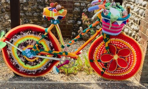 Yarnbomb Sisters - brightly coloured knitted ladies' bicycle.