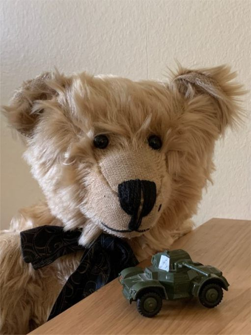 Bertie looking at a Dinky Toy model of an armoured car.