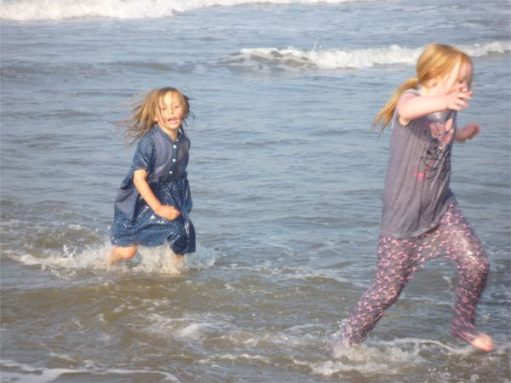 Ayla and Layla playing in the sea at Whitby.