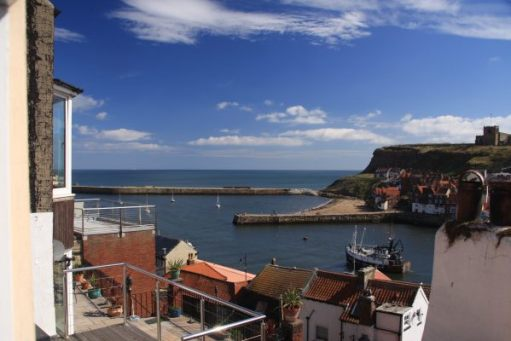 Morning has broken on a glorious day. Here is the view of Whitby harbour from the cottage.