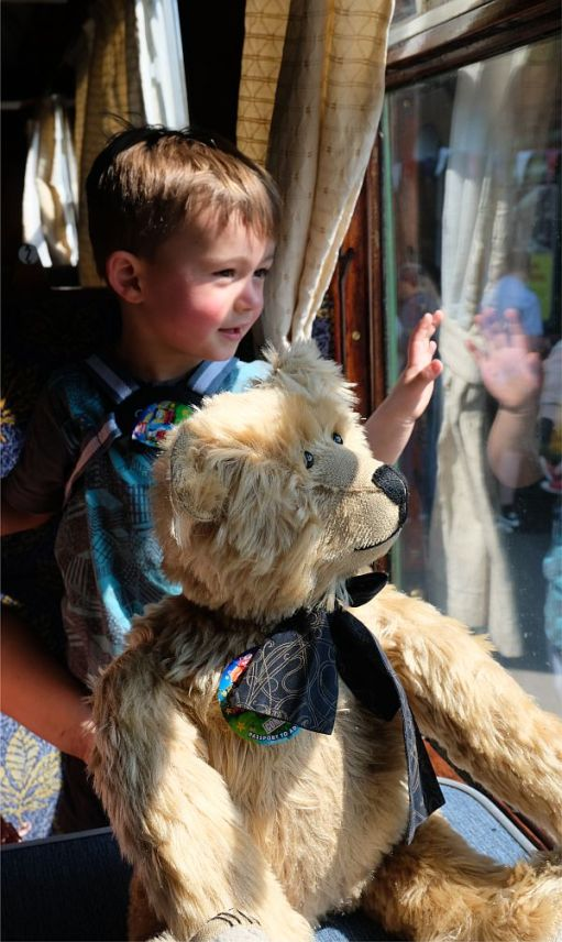 Jay, with Bertie, waving from a steam train. 2018.