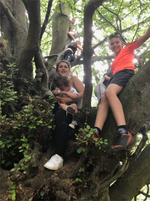 Some of Bobby's grandchildren (plus great grandson) in the Witches Broom Tree.