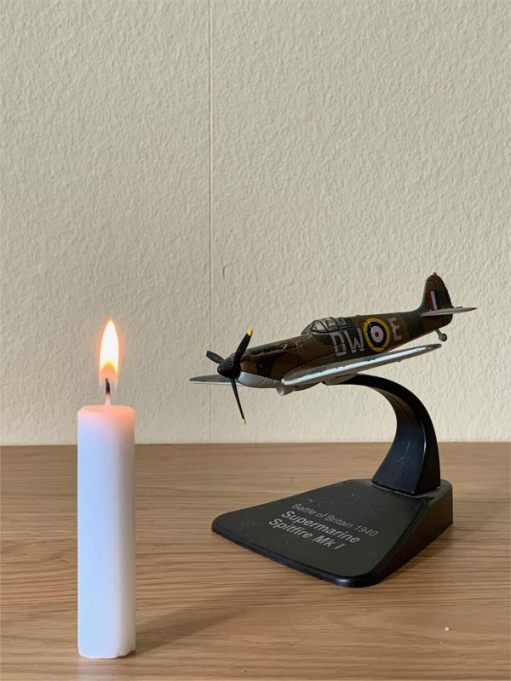 Model of a Supermarine Spitfire Mk I and a Candle Lit for Diddley.