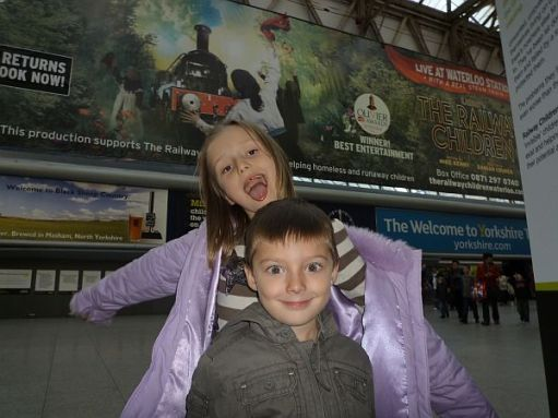 Layla and Sonny posing at Waterloo Station.