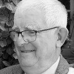 Black and white headshot of Bobby.