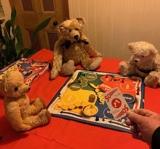 Bertie, Eamonn and Trevor playing Sorry with Bobby.