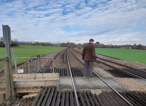Bobby standing in the middle of the Railway Crossing looking north, towards Holmwood.