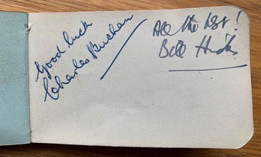 "Two signatures on a page in the Little Pink Book: ""Good Luck, Charles Buchan"" and ""All the Best, Bill Hicks""."