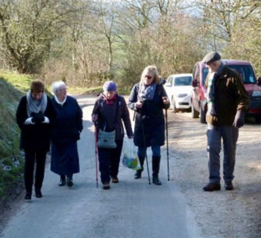 Bobby and four ladies walking up a road.