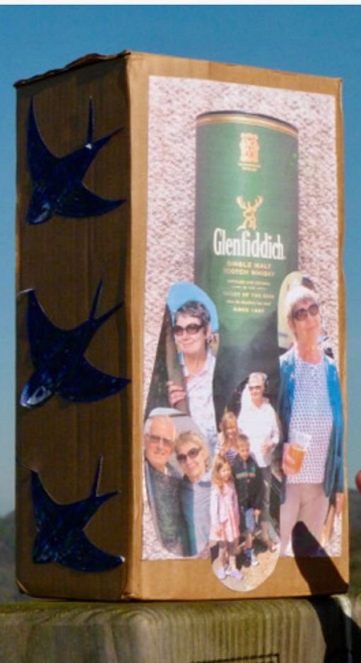 The ashes in a box with pictures of a Glenfiddich box plus photos of Diddley & Bobby.