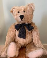 Bertie sat down, wearing a black cravat.