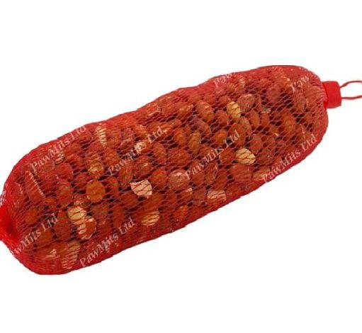 Red net full of peanuts. Ready to hang in the garden.