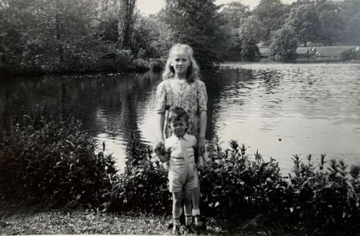 Black and White photo of Wendy and Bobby by a pond.