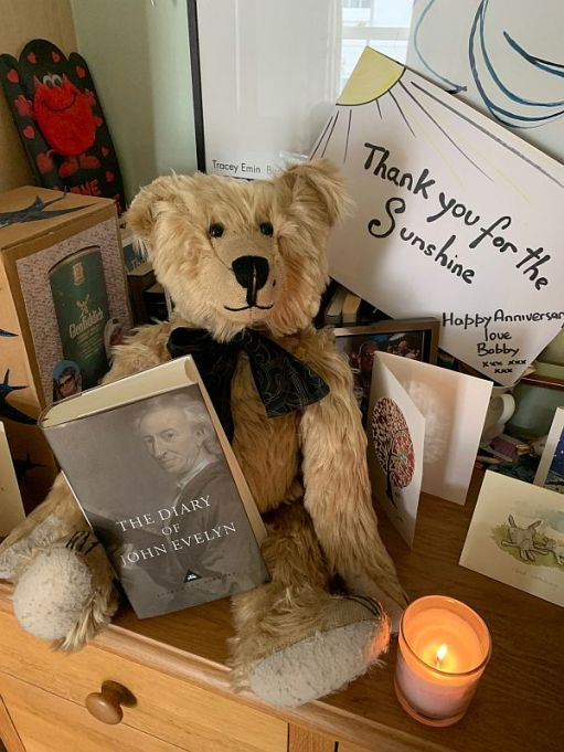 Bertie, a candle lit for Diddley and a copy of John Evelyn's diary.