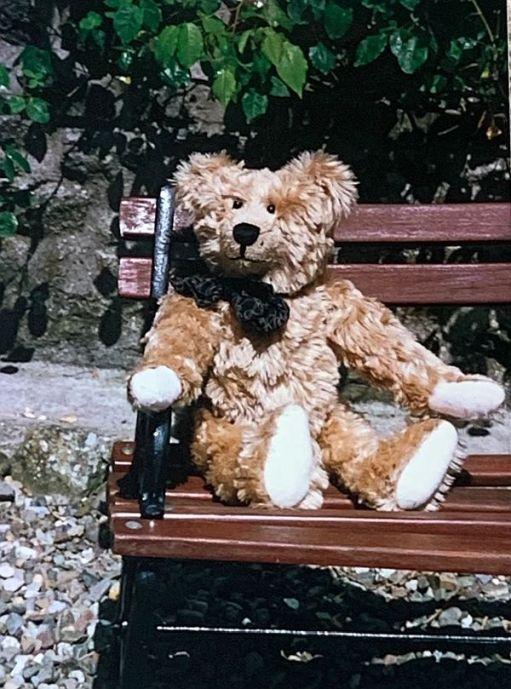 Bertie sat on a bench.
